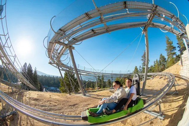 A pair of thrill seekers navigate the track of the Mineshaft Coaster at Alpine Slide Big Bear in Big Bear Lake in an undated photo. Alpine Slide unveiled the new attraction on Wednesday, May 19, 2021.