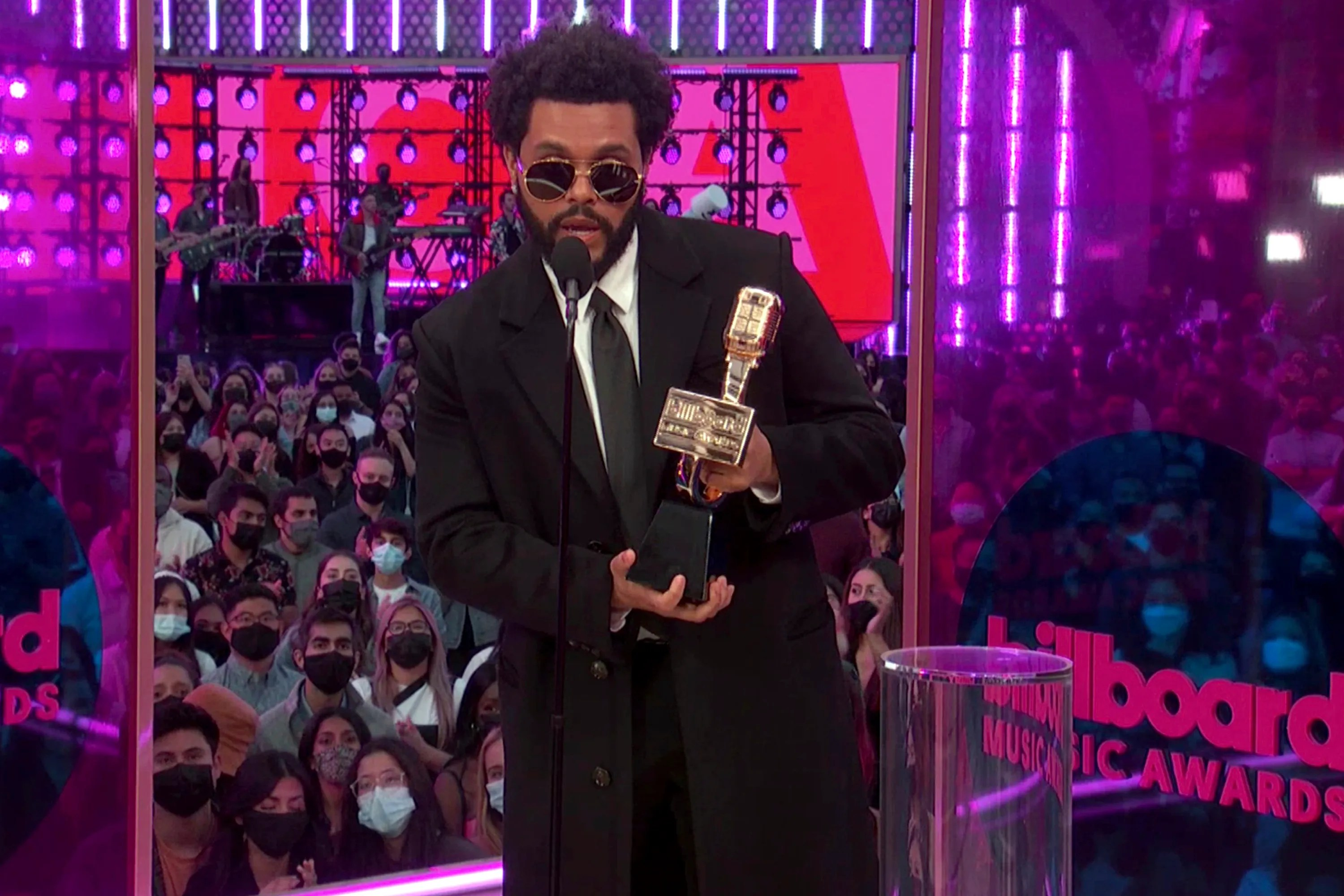 The Weeknd accepts the top artist award.