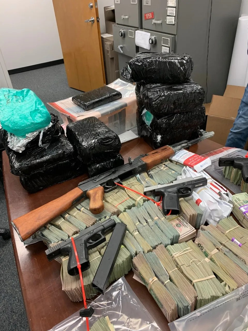 Piles of guns, drugs and drug money