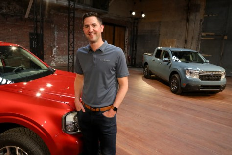 Trevor Scott the Ford Motor Company marketing manager for the Ford Ranger and Maverick in front of the 2022 Ford Maverick Lariat FX4 and the XLT Hybrid at a studio in Detroit on Wednesday, June 2, 2021.