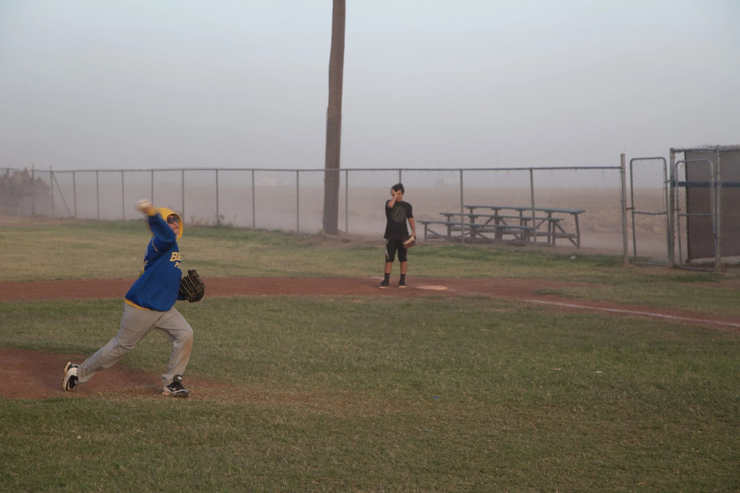 Kids play baseball during a dust storm in Westmorland, Calif., on March 30, 2017.