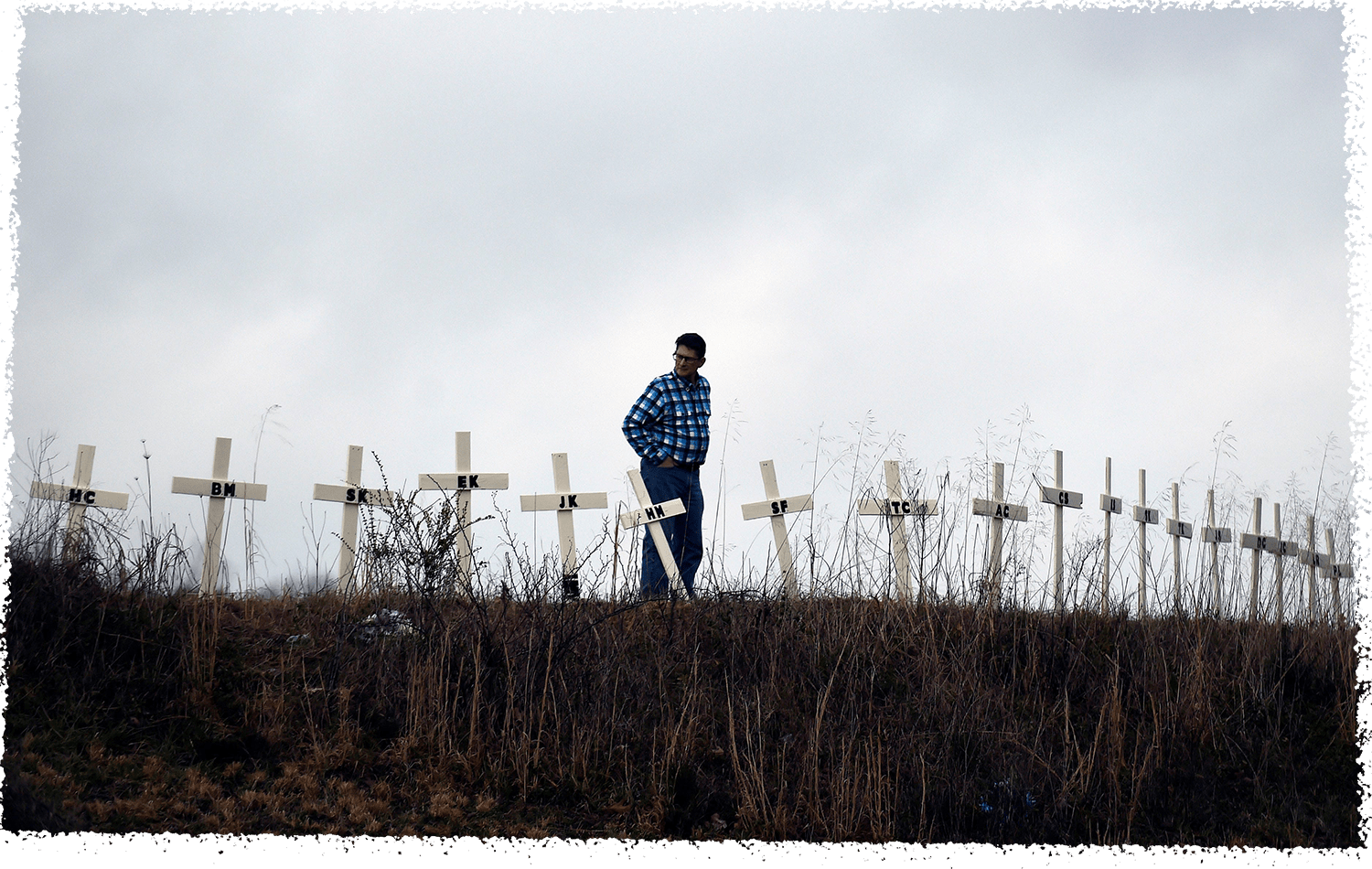 Allen Jingst looks at the 18 crosses erected on a small hill in memory of the victims who died in deadly tornadoes in Cookeville, Tenn.