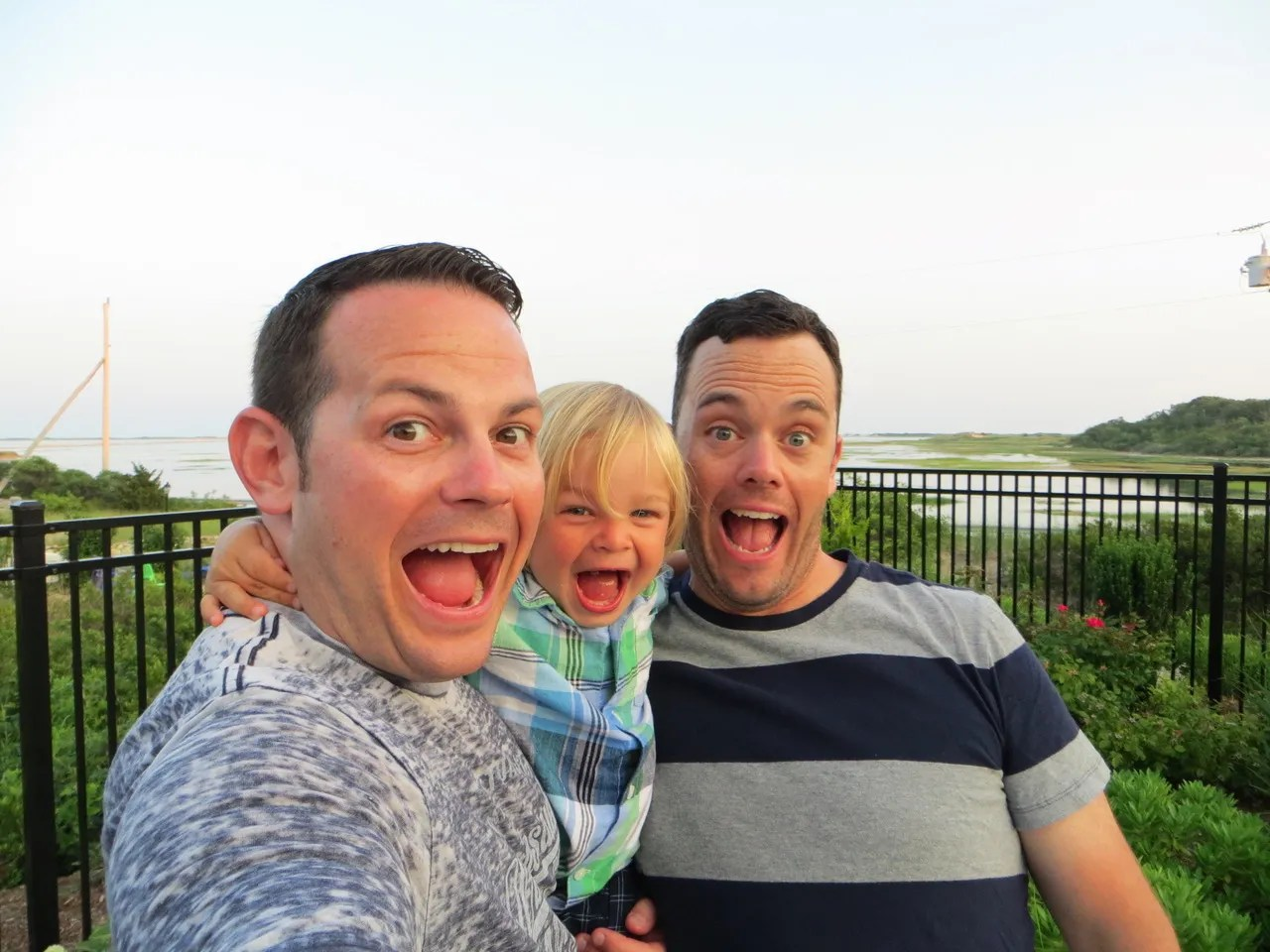 LeeMichael McLean and Bryan Furze pose with their son. During more than five years of harassment, about 30 pieces of mail with homophobic fake names on them were sent to the couple's home in Milton, Massachusetts.