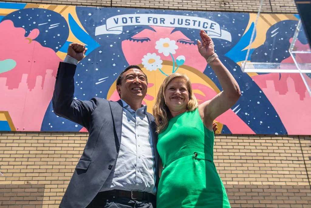 """Mayoral candidates Andrew Yang and Kathryn Garcia wave to New Yorkers after speaking at the AAPI Democracy Project's """"Voting is Justice Rally"""" in Chinatown on Sunday in New York."""