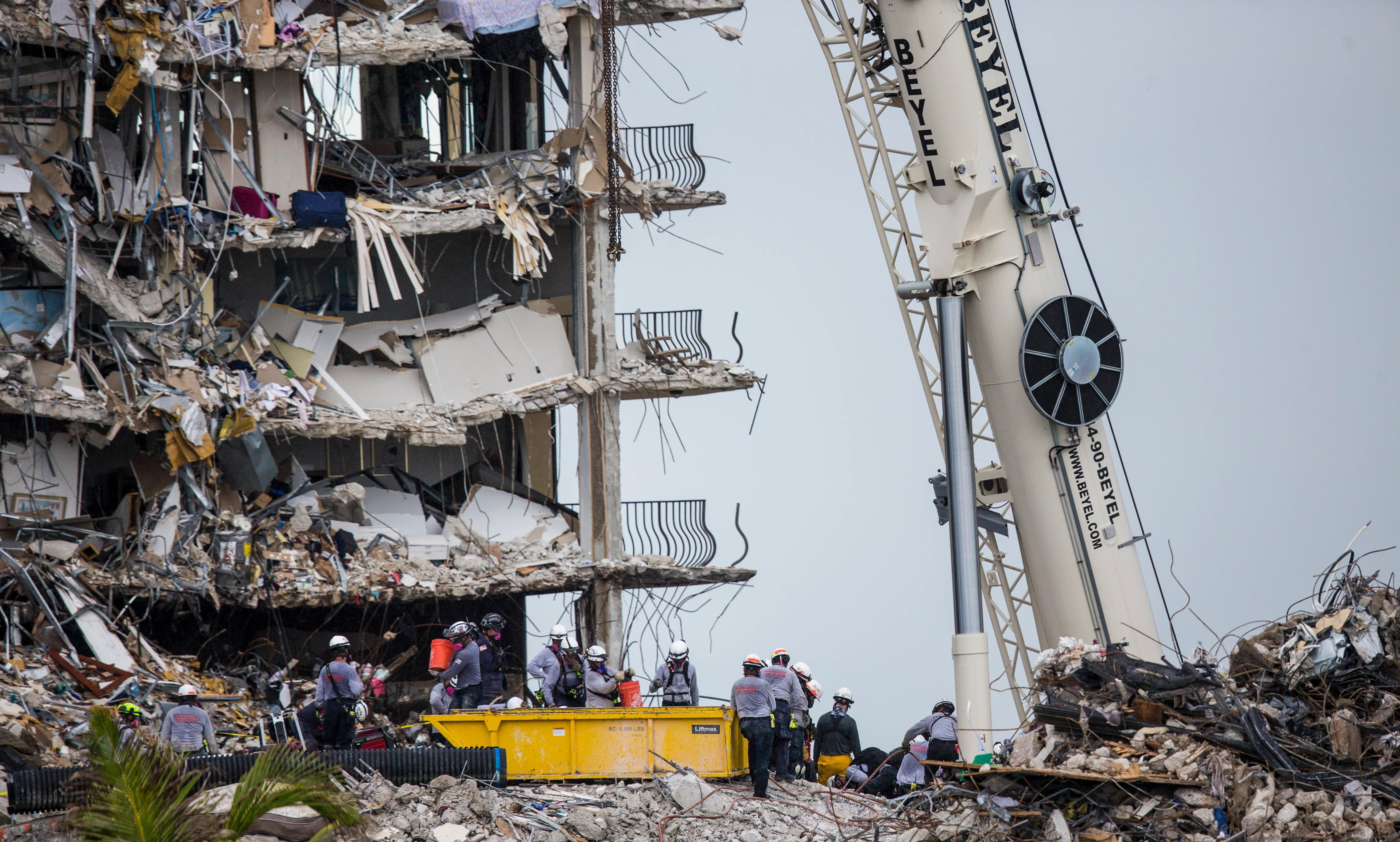 Rescuers continue to search through the rubble  of the Champlain Towers south condo collapse in Surfside, Fla. on Tuesday, June 29, 2021.