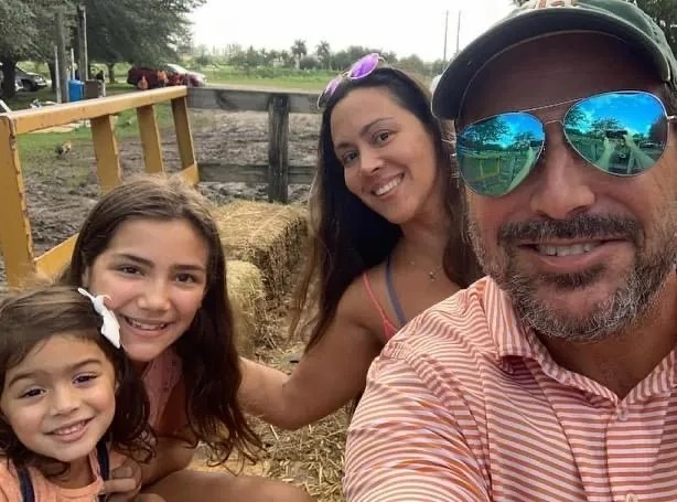 Marcus Guara, pictures here with daughters Emma, left, and Lucia and his wife Ana, died in the Surfside tower collapse. He was 52.