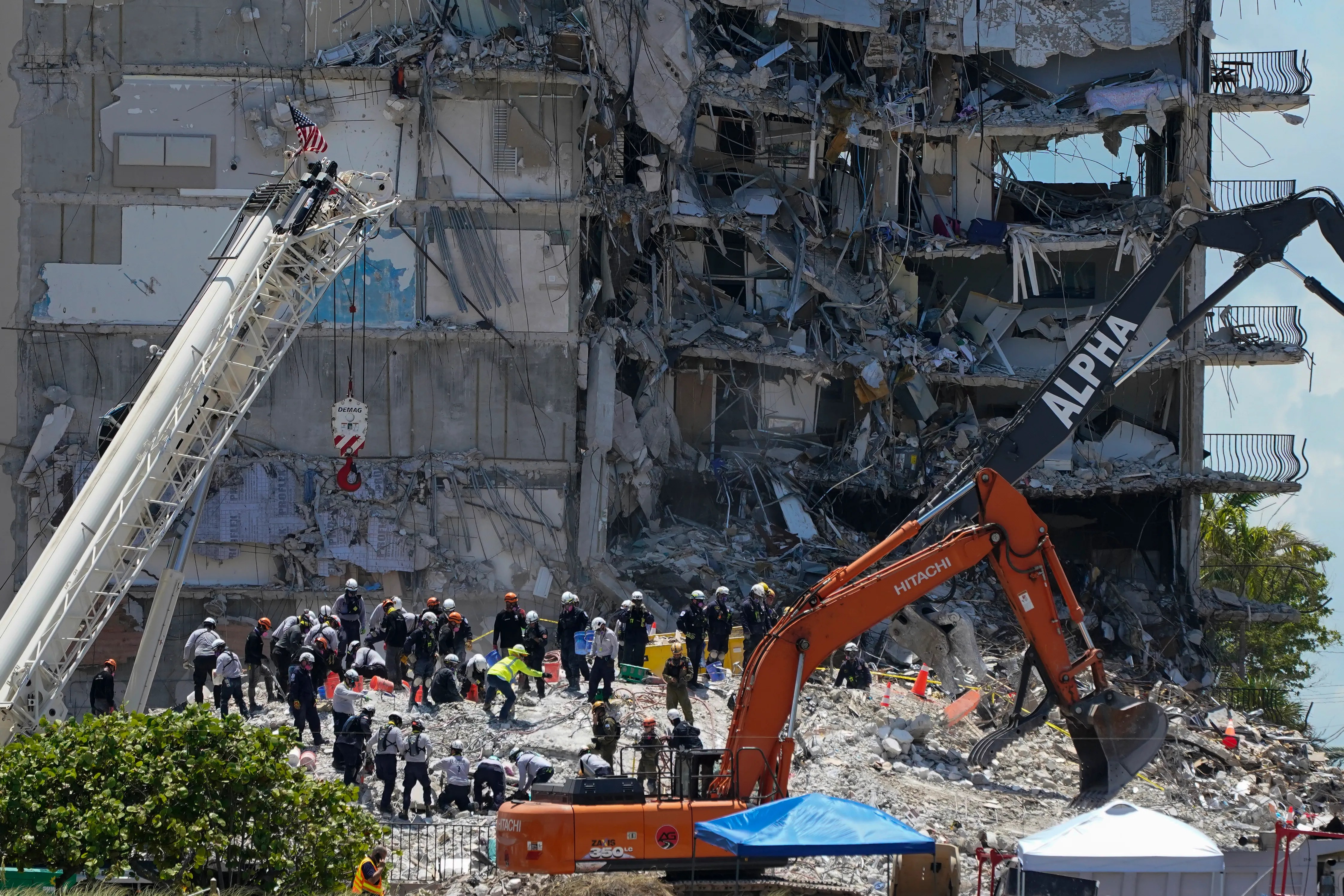 Search and rescue personnel work atop the rubble at the Champlain Towers South condo building, where scores of victims remain missing more than a week after it partially collapsed, Friday, July 2, 2021, in Surfside, Fla.