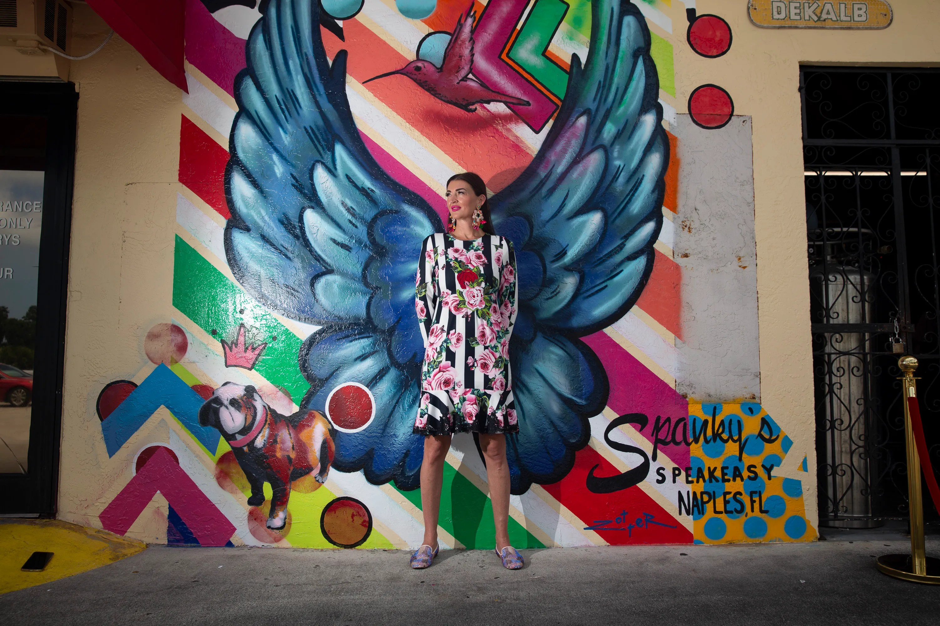 Emily Monty poses for the first angel wings photo at her restaurant on Spanky's Speakeasy in Naples on Friday, July 09, 2021.