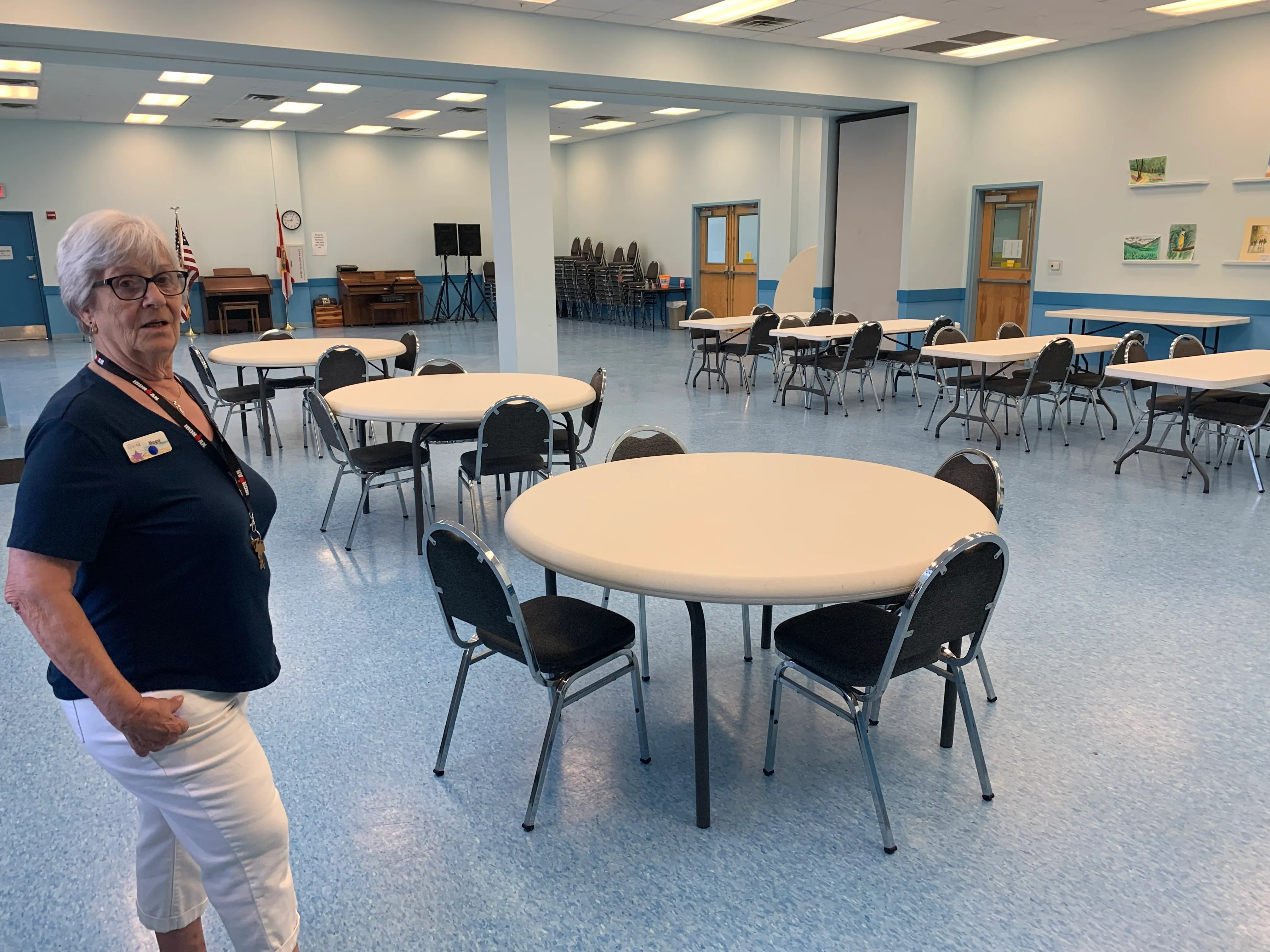 Mugsy Parens stands in the Oatfield Center's cafeteria area, where Coffee Shoppe is held each week.