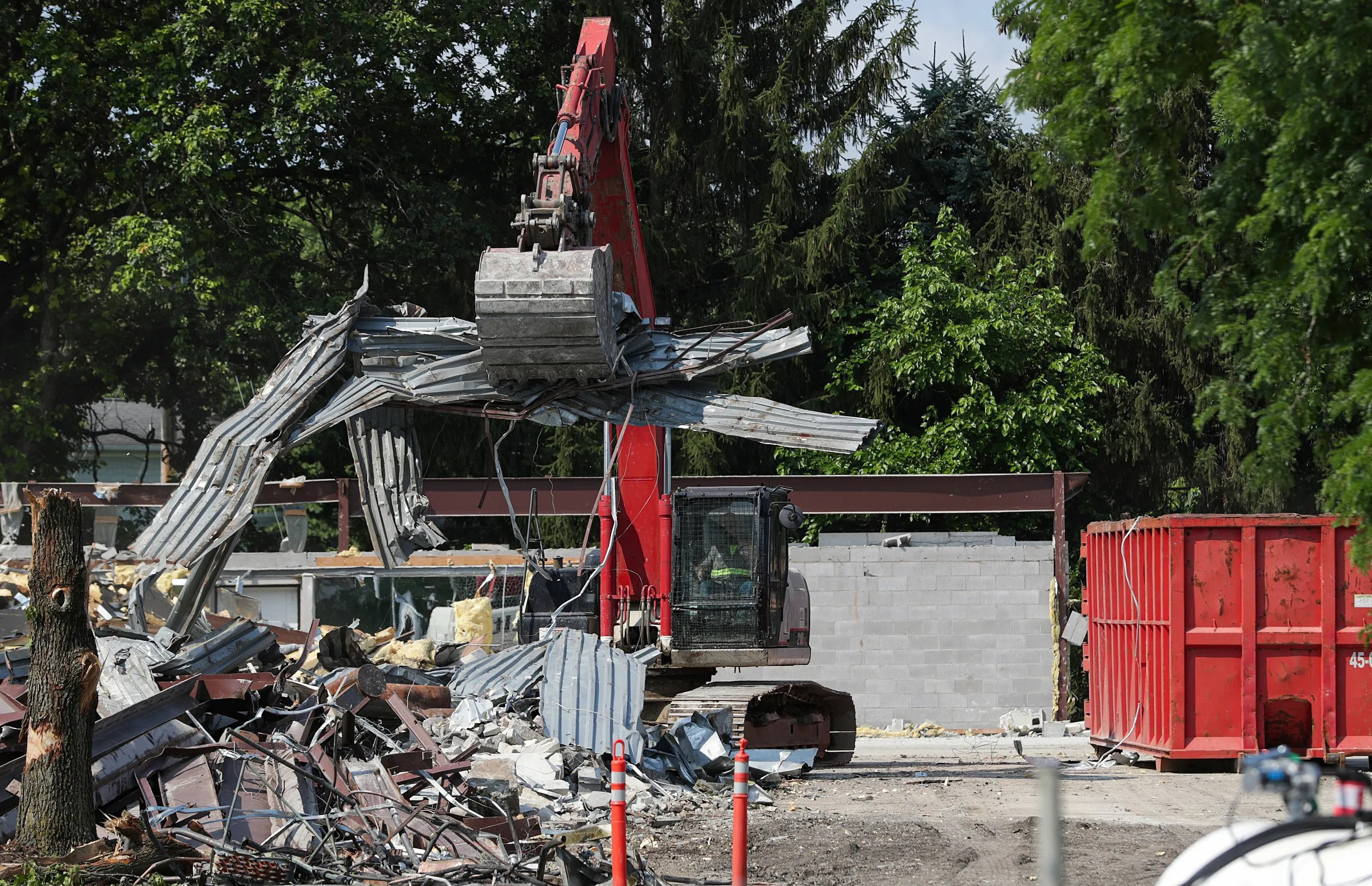 A construction crew removes debris from the demolished former facility to begin building the new Broad Ripple Park Family Center on Wednesday, July 14, 2021, in Indianapolis. The new facility, which will cost an estimated $19.7 million and open by the end of 2022, will feature an indoor track, children's playground, updated fitness center, group meeting area and health clinic.