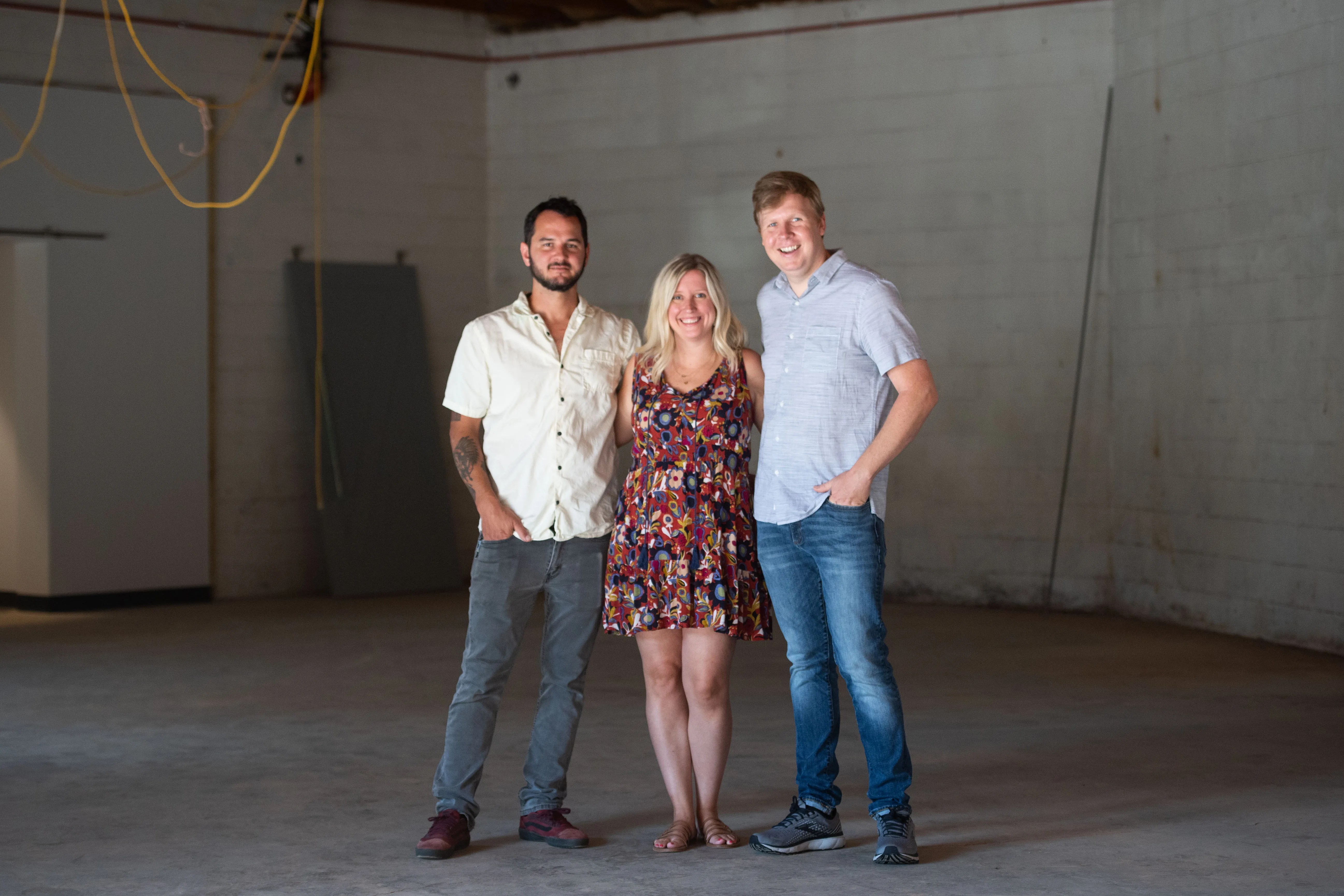 From left to right, Alex Morgan, Beth and Greg McPhee, chef and co-owners of upcoming restaurant Mr. Crisp, pose for a photo at the location for the restaurant in Greenville, S.C. Friday, July 16, 2021.