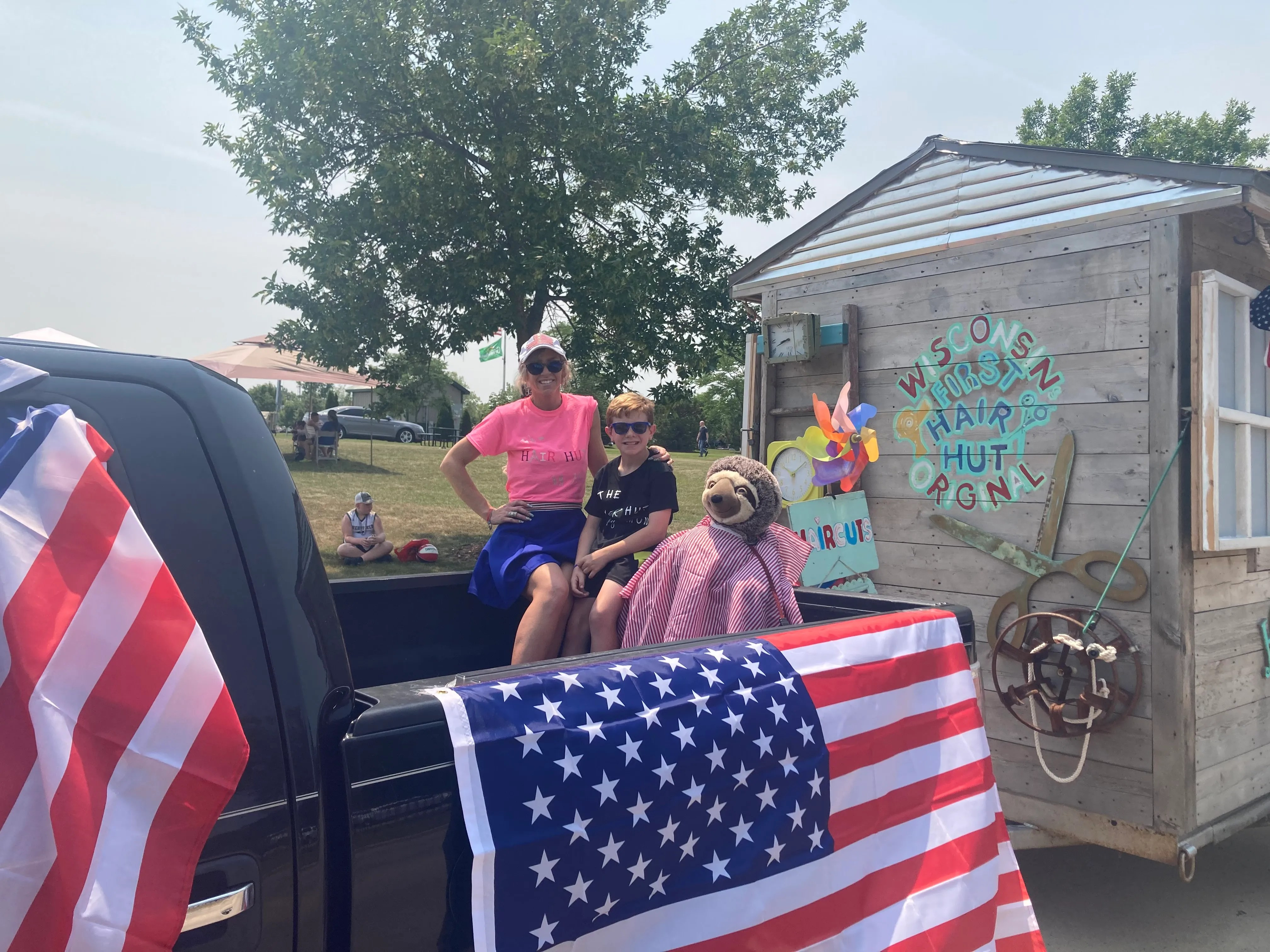 Mandy Jane Ashenfelter pictured with her son Iren Abler, started a mobile hair salon last July called the Hair Hut.  The Hair Hut goes to places in the greater Milwaukee area for $10 haircuts.
