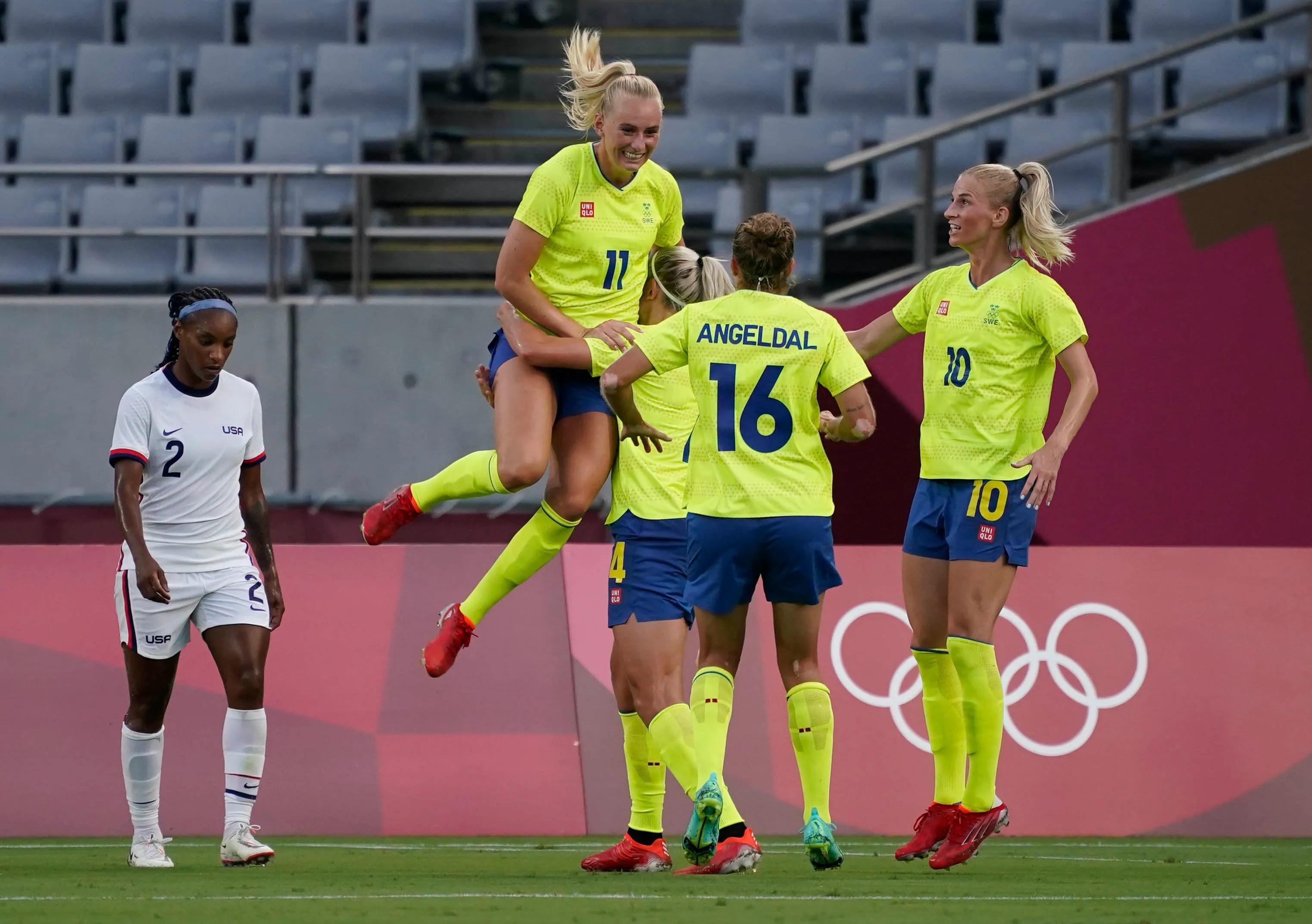 Sweden striker Stina Blackstenius (11) celebrates with her teammates after scoring a goal against the USA team during the first half of the Tokyo 2020 Olympic Summer Games at Tokyo Stadium.