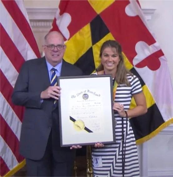 U.S. Paralympian Becca Meyers receives a citation from Gov. Larry Hogan.