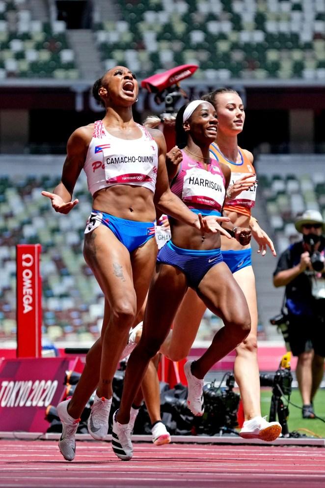 Jasmine Camacho-Quinn, left, celebrates winning the gold medal as American Keni Harrison celebrates winning the silver in the 100-meter hurdles.