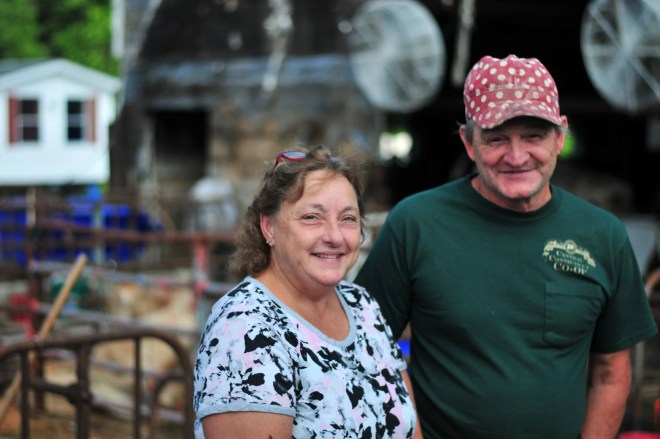 Dairy farmers Bonnie and Paul Bettencourt pause for a photo at Bettencourt Farm in Rehoboth on Aug. 6, 2021.
