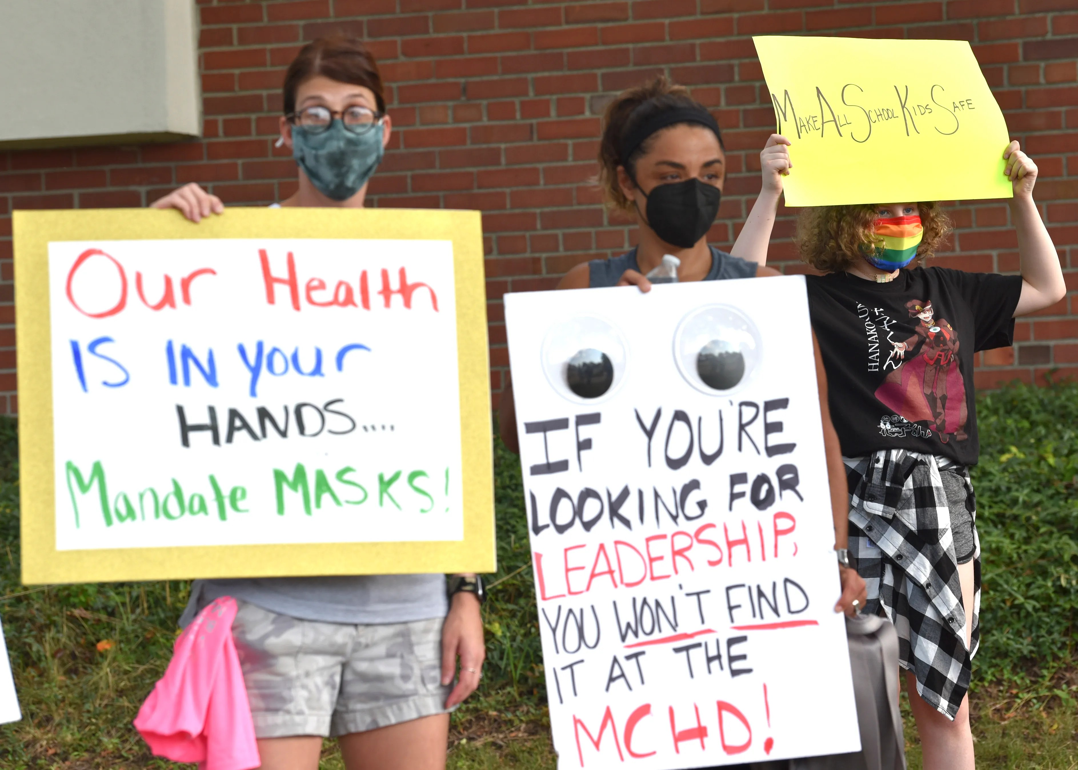 Approximately 25 people attend the Macomb County Parents for Safe In-Person School rally in front of the Macomb County Health Department to ask the health department to mandate mask wearing for all Macomb County K-12 students, just as Oakland County did this week.