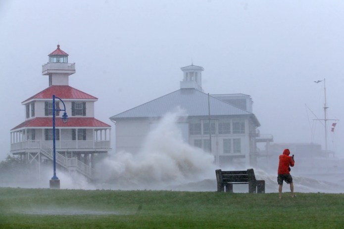 Waves crash against the New Canal Lighthouse on Lake Pontchartrain as Hurricane Ida approaches New Orleans on Aug. 29, 2021.