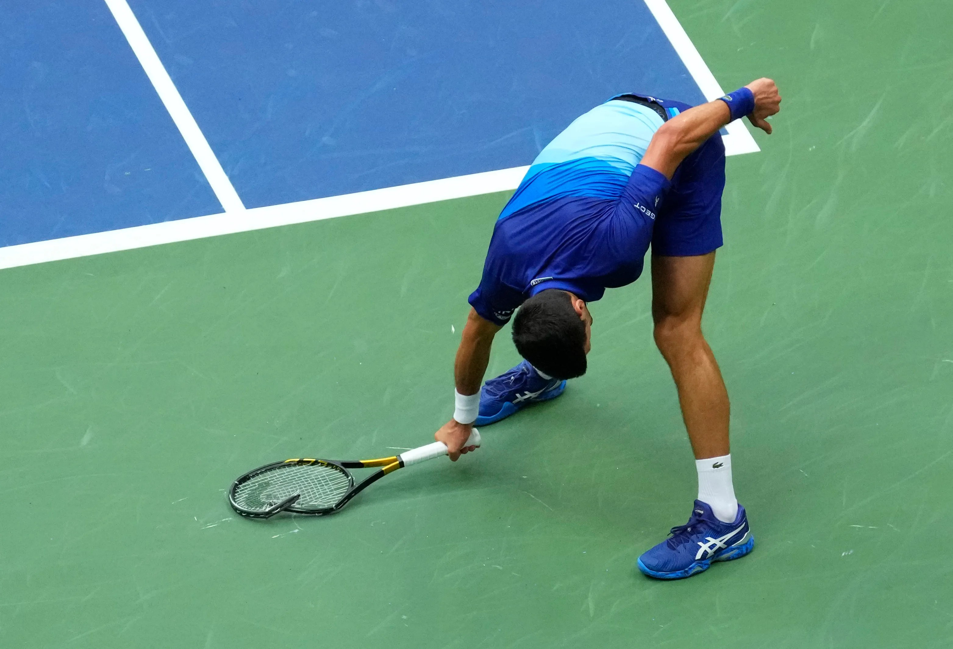 Novak Djokovic smashes his racquet during the second set of the U.S. Open men's final.