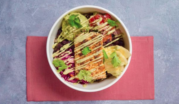 Holy Bowly's The Tropical — wild black coconut rice, black beans and seared mahi mahi drizzled in a citrus-avocado puree, all topped with pico de gallo, guacamole, passionfruit slaw and grilled pineapple.