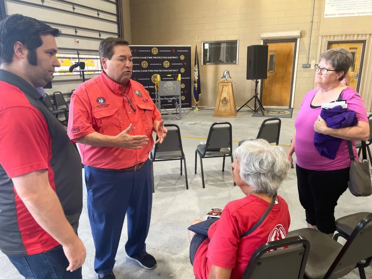 Louisiana Lt. Gov. Billy Nungesser, center, speaks with residents during a town hall meeting Friday in Houma about Hurricane Ida recovery.