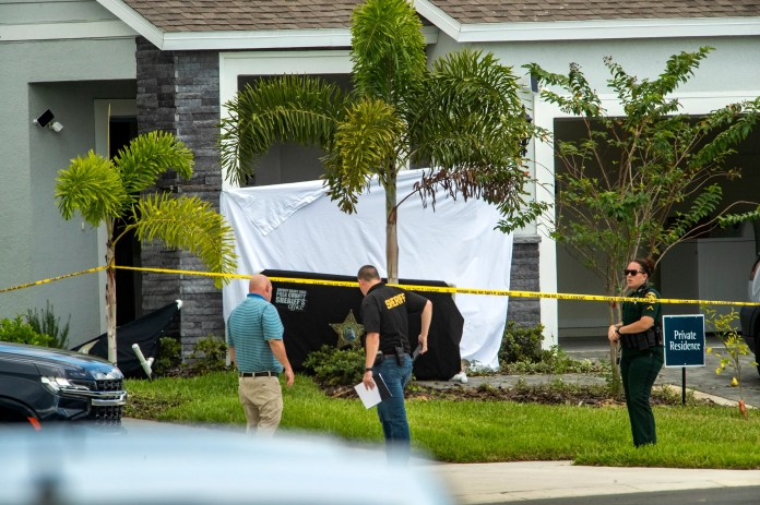 Polk County Sheriff investigators search the scene of a fatal attack in Davenport, Fla., on Saturday, Oct. 2, 2021. ERNST PETERS/ THE LEDGER