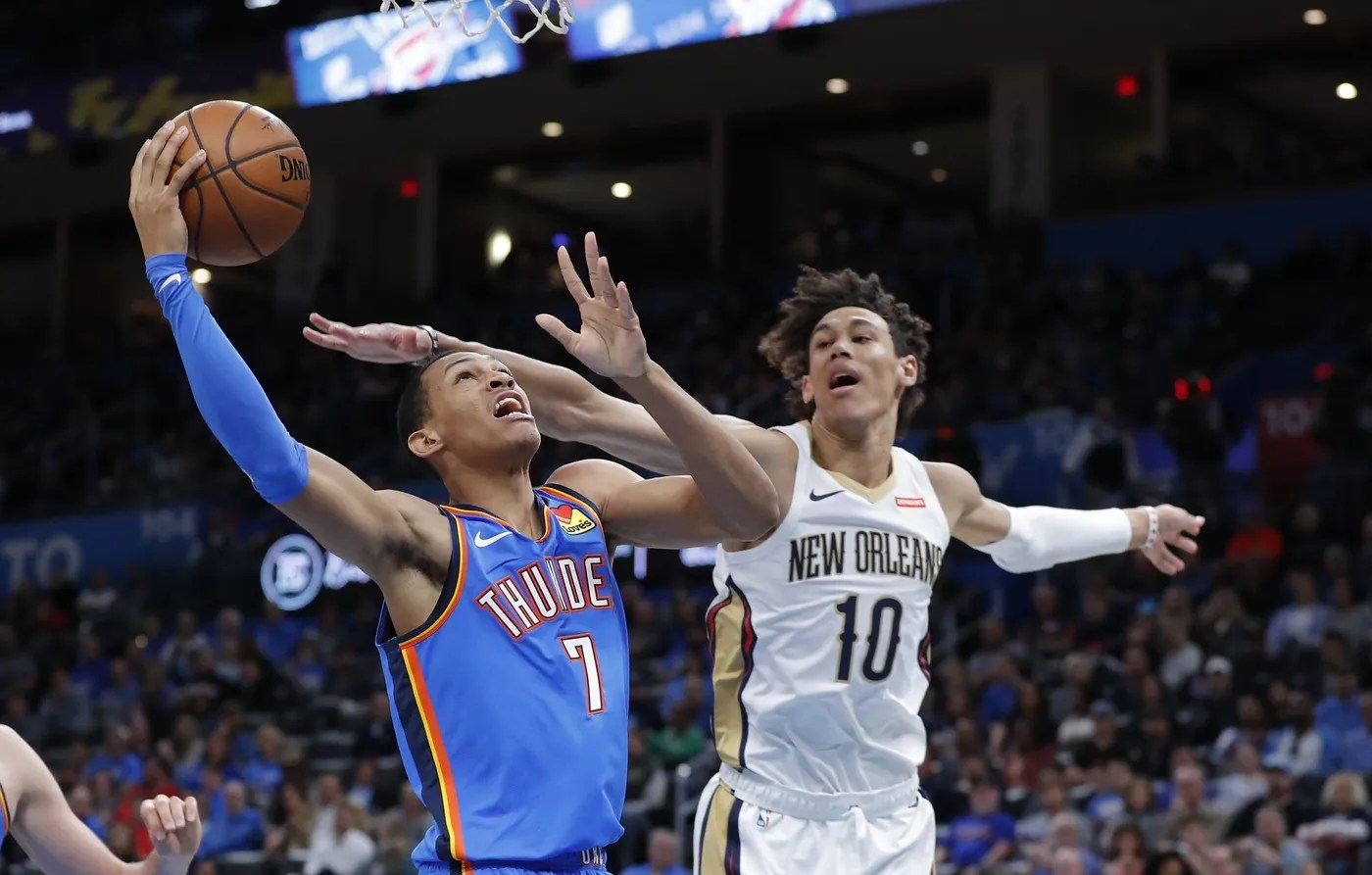 Nov 2, 2019; Oklahoma City, OK, USA; Oklahoma City Thunder forward Darius Bazley (7) shoots the ball as New Orleans Pelicans center Jaxson Hayes (10) defends the shot during the second half at Chesapeake Energy Arena. Oklahoma City won 115-104. Mandatory Credit: Alonzo Adams-USA TODAY Sports