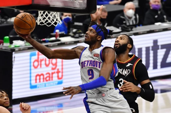Jan 27, 2021; Cleveland, Ohio, USA; Detroit Pistons forward Jerami Grant (9) drives to the basket against Cleveland Cavaliers center Andre Drummond (3) during the third quarter at Rocket Mortgage FieldHouse.