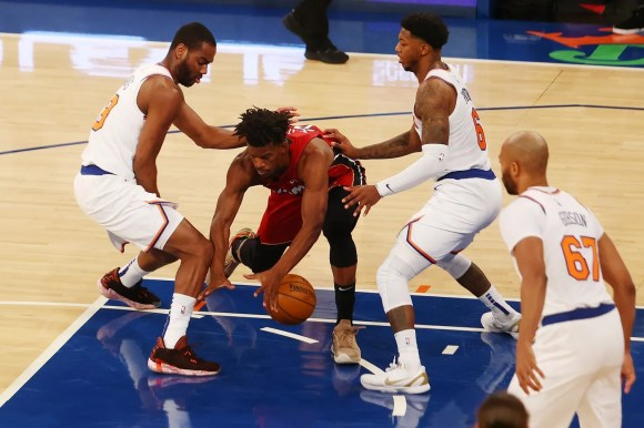 Feb 7, 2021; New York, New York, USA; Austin Rivers #8 and Elfrid Payton #6 of the New York Knicks defends against Jimmy Butler #22 of the Miami Heat at Madison Square Garden on February 07, 2021 in New York City.