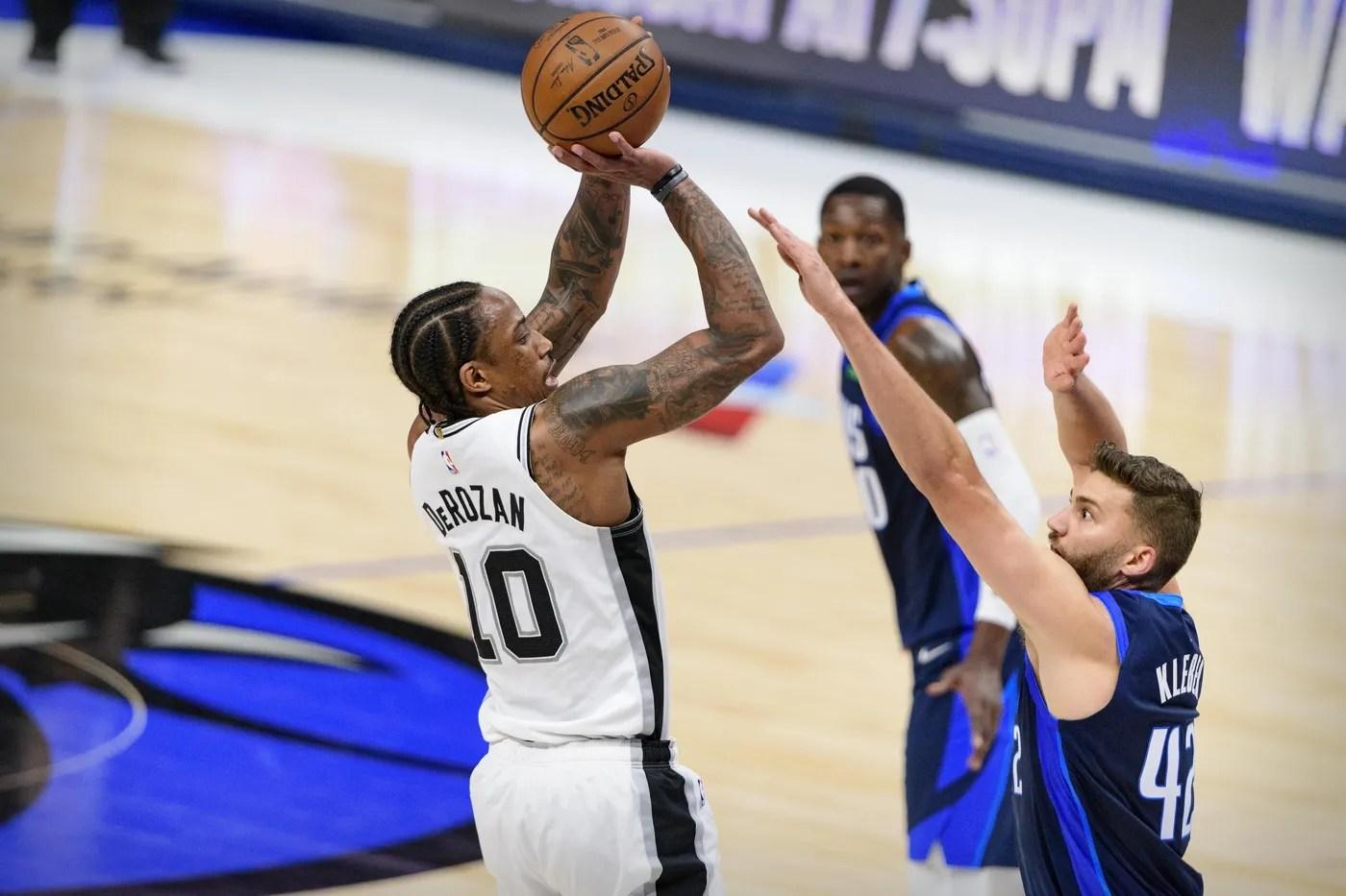 Mar 10, 2021; Dallas, Texas, USA; San Antonio Spurs forward DeMar DeRozan (10) shoots over Dallas Mavericks forward Maxi Kleber (42) during the second quarter at the American Airlines Center.