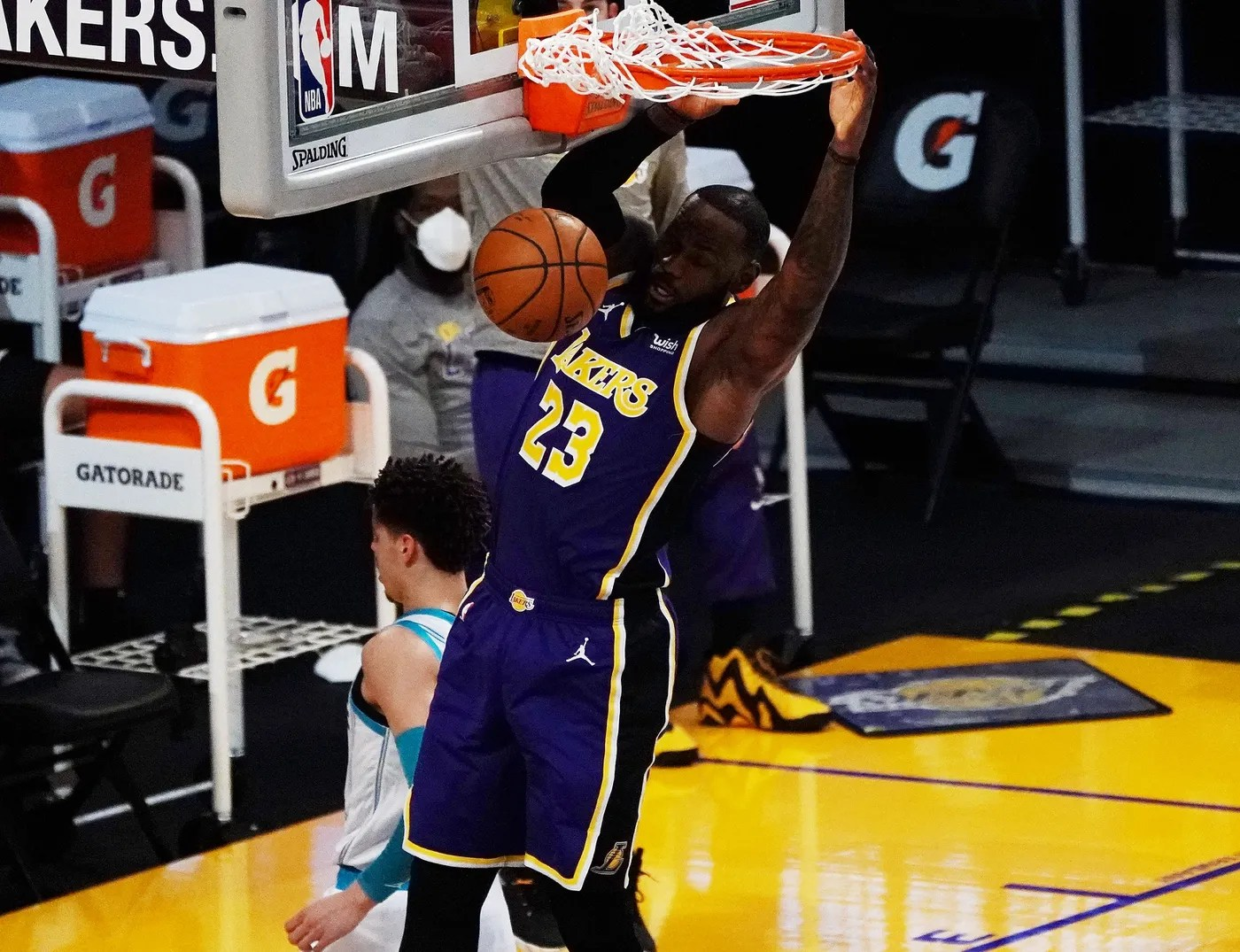 Mar 18, 2021; Los Angeles, California, USA; Los Angeles Lakers forward LeBron James (23) dunks for a basket against the Charlotte Hornets during the first half at Staples Center. Mandatory Credit: Gary A. Vasquez-USA TODAY Sports