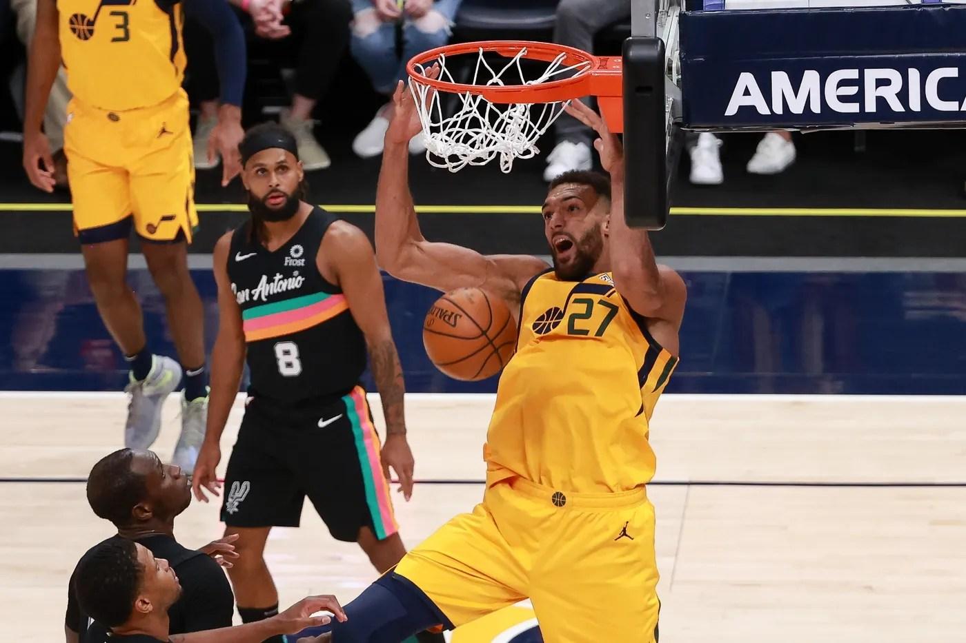 May 3, 2021; Salt Lake City, Utah, USA; Utah Jazz center Rudy Gobert (27) dunks the basketball during the fourth quarter against the San Antonio Spurs at Vivint Arena. Utah Jazz won 110-99. Mandatory Credit: Chris Nicoll-USA TODAY Sports