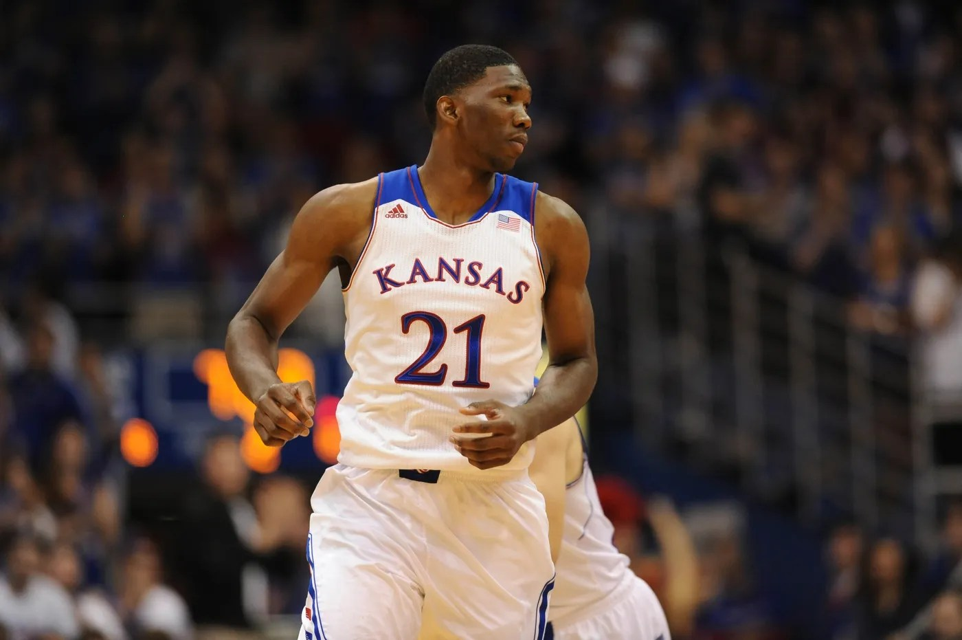 Nov 8, 2013; Lawrence, KS, USA; Kansas Jayhawks center Joel Embiid (21) walks to the near end of the court during the second half of the game against the Louisiana Monroe Warhawks at Allen Fieldhouse. Kansas won 80 - 63.