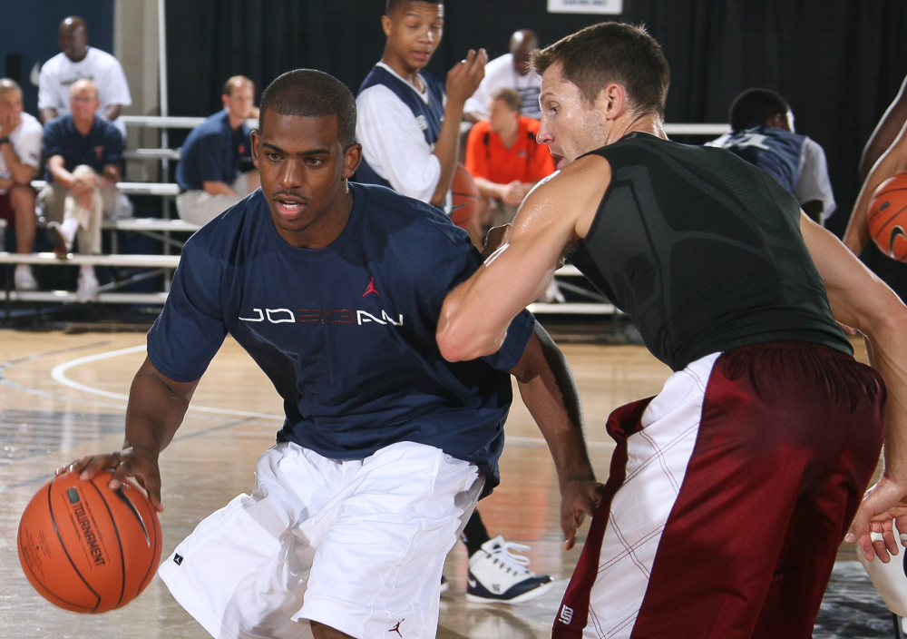 Chris Paul playing basketball with Ganon Baker