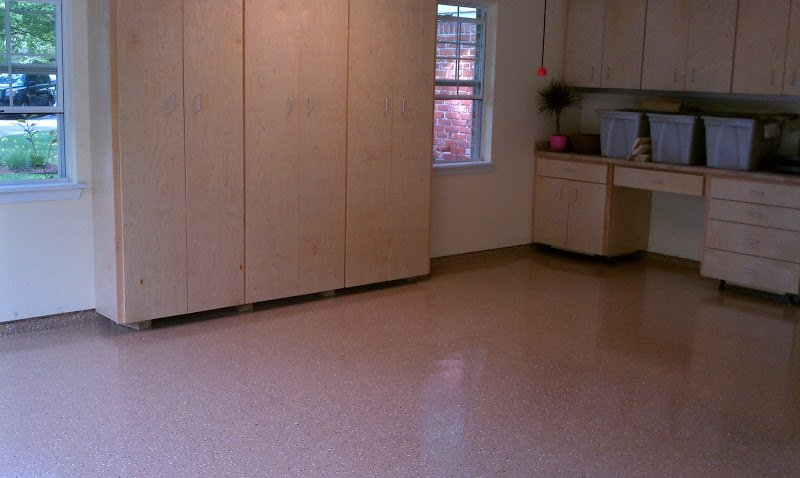 Photo from same project as Before Photo. Photo shows completed garage floor that has been prepped, epoxy coated, chipped and clear coated. What a difference!