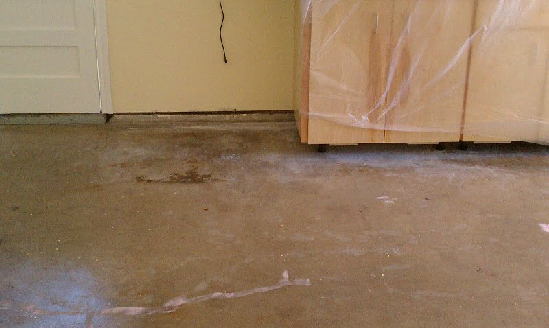 Photo from one of our Projects. The garage floor is in bad shape. We had to grind the floor, etch it, and then clean the floor. Next, we filled in the cracks and holes. This  process usually takes about 6 hours.