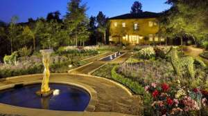 backyard with decomposed granite paths, flower gardens, topiaries, and fountains