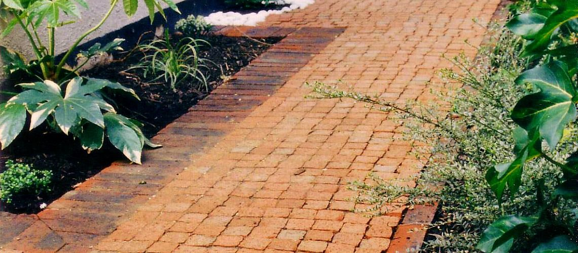 A cobble path with brick edge