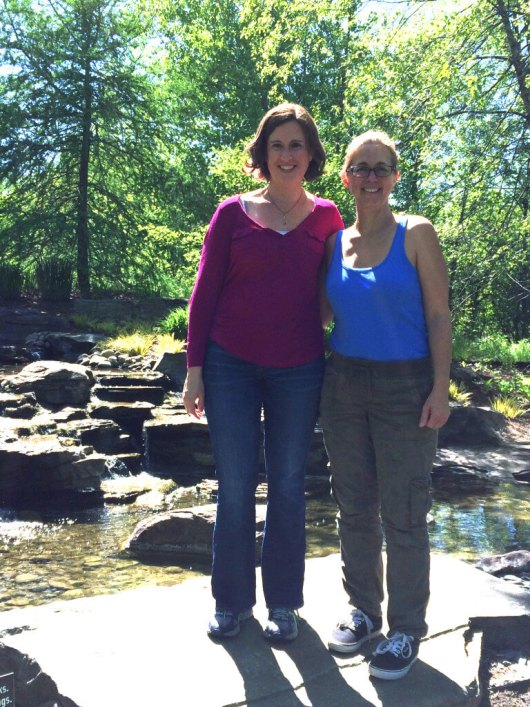 Me and my friend posing in front of the waterfall