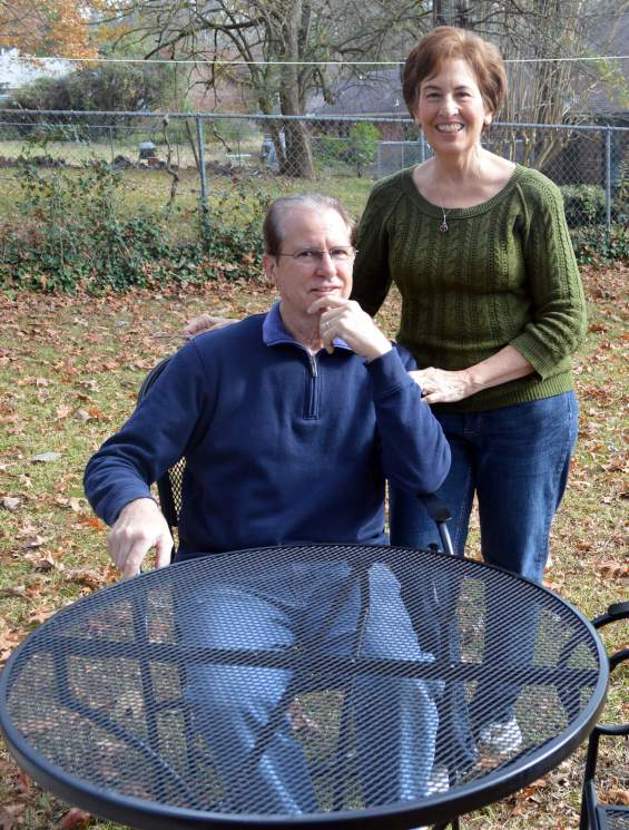 My parents with the newly refurbished table and chairs