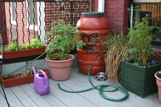 Add attachments to rain barrels for efficient watering