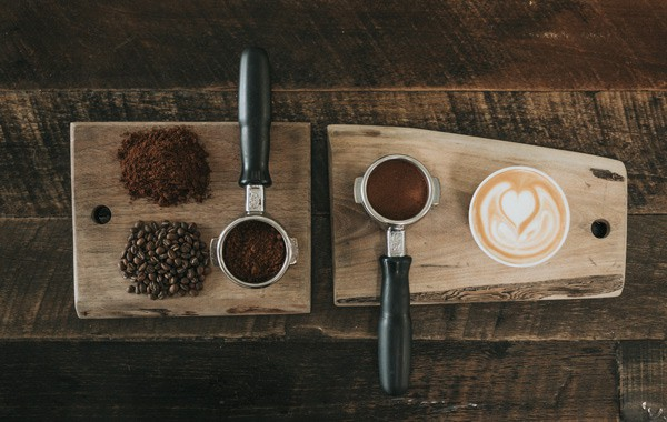 coffee beans beside coffee powder