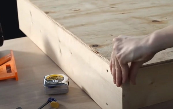 person attaching plywoods