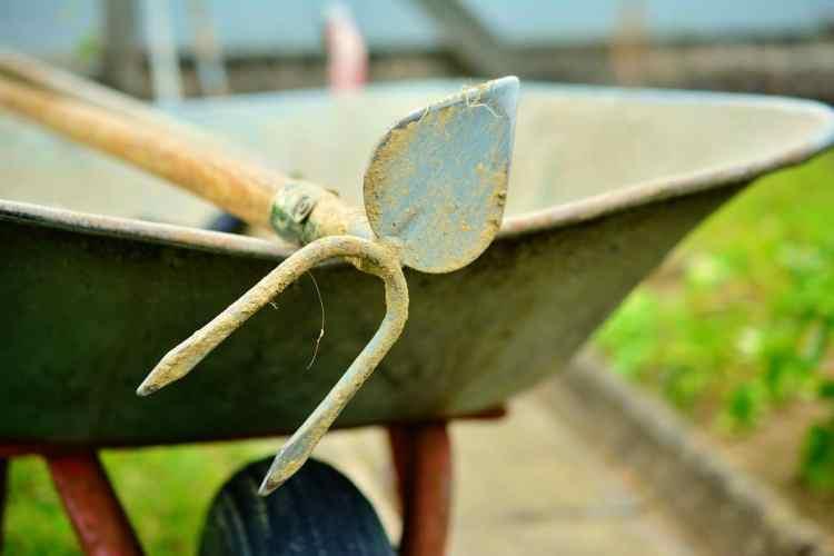 wheelbarrow with a hoe and tiller