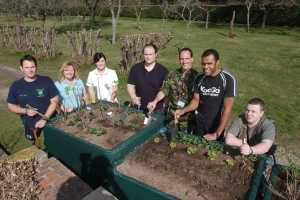 Headley Court staff and servicemen with donated raised beds