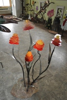 Glass flowers with metal stems in a studio