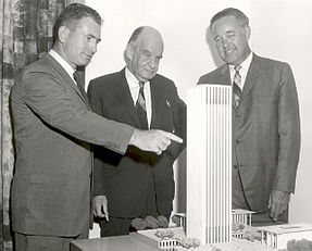 Model of Electronics Research Centers first phase of construction is examined by (from left) Dr. Albert J. Kelley, Deputy Director; Edward Durell Stone, architect, of the joint venture team which designed the facilities; and Dr. Winston E. Kock, Director. Public domain photo from Wikipedia.