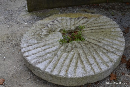 A millstone at the site.