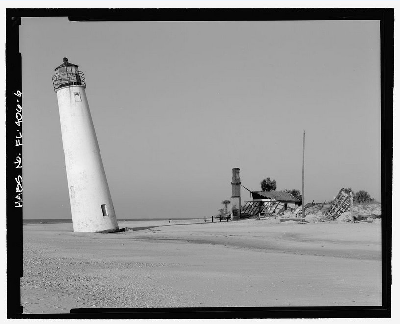 This 1998 image of the lighthouse shows the precarious tilt gained after Hurricane Opal. Historic American Building Survey photo by by Tom Baird.
