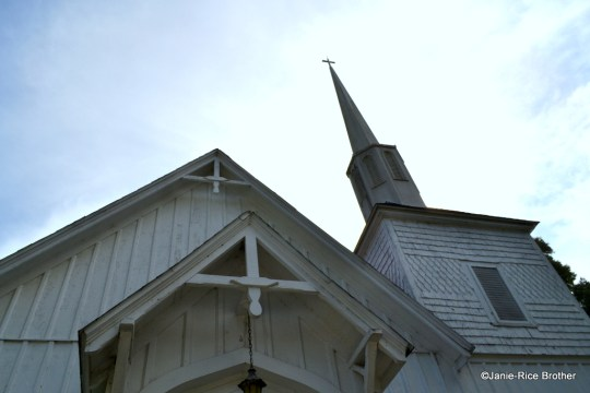 A detail of the modest bargeboard on the front gable facade, and the shingled bell tower.